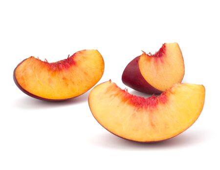 Nectarine fruit segments isolated on white background Stock Photo - 13333395