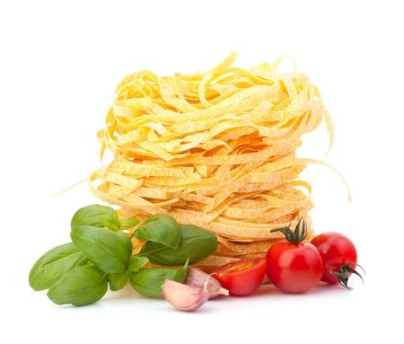 Italian pasta tagliatelle nest and cherry tomato isolated on white background Stock Photo - 13332035