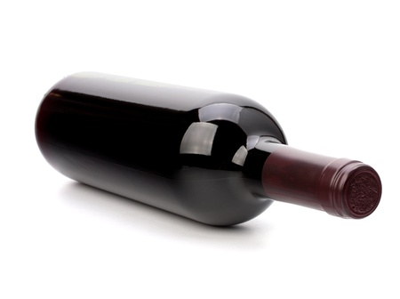 glass of red wine: red wine bottle isolated on white background