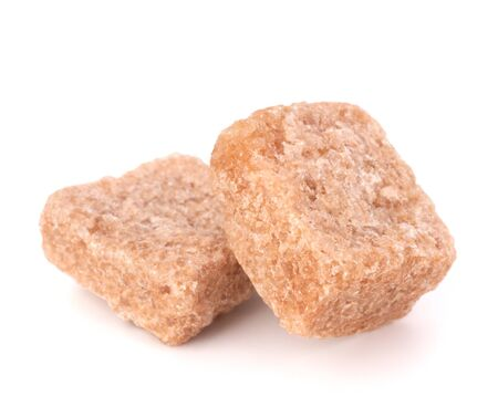 Lump brown cane sugar cubes isolated on white background photo