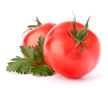 Two tomato vegetables and parsley leaves still life isolated on white background cutout photo