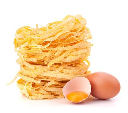 Italian pasta tagliatelle nest isolated on white background photo