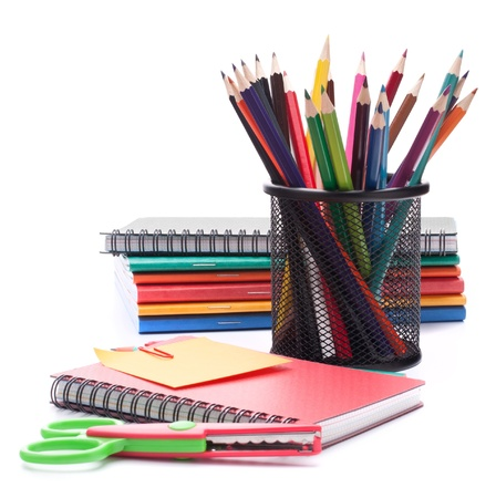 Notebook stack and pencils. Schoolchild and student studies accessories. photo