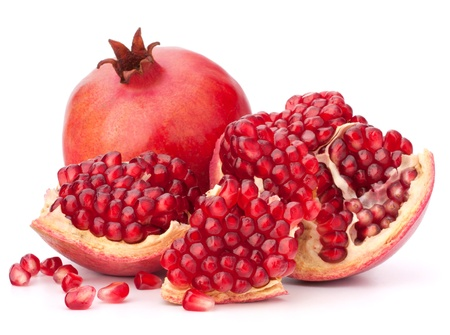 pomegranate juice: Ripe pomegranate fruit isolated on white background cutout