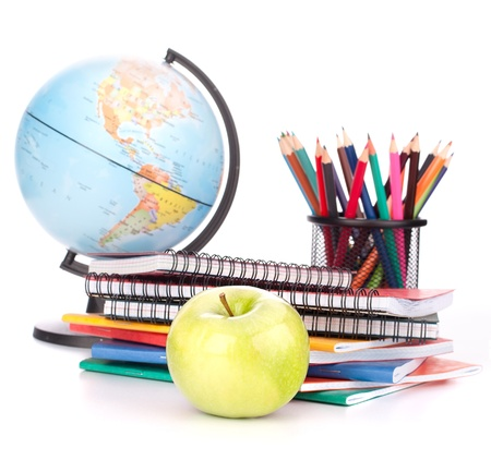 school supplies: Globe, notebook stack and pencils. Schoolchild and student studies accessories. Back to school concept.