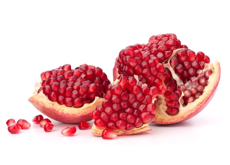 pomegranate juice: Broken pomegranate segment isolated on white background cutout Stock Photo
