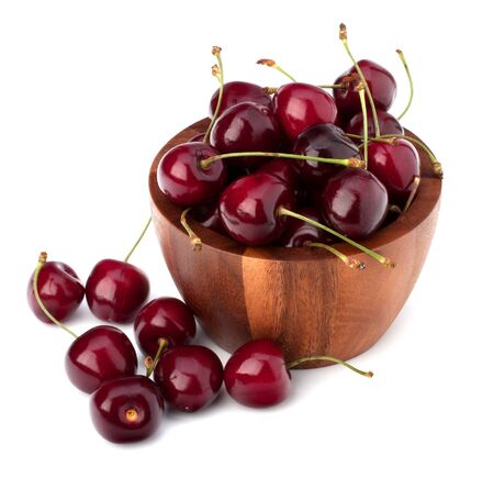 Cherry in wooden bowl isolated on white background photo