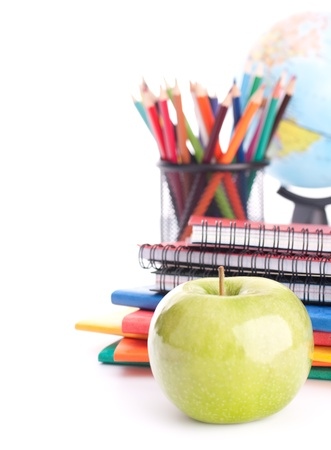 Apple, notebook stack and pencils. Schoolchild and student studies accessories. Back to school concept. photo
