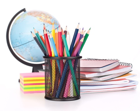 Globe, notebook stack and pencils. Schoolchild and student studies accessories. Back to school concept. Stock Photo - 14617901