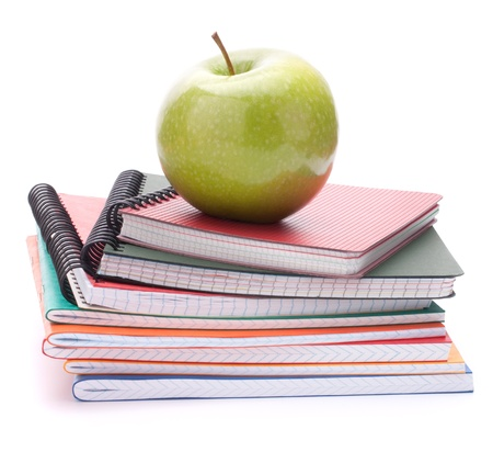 Notebook stack and apple. Schoolchild and student studies accessories. Back to school concept. photo