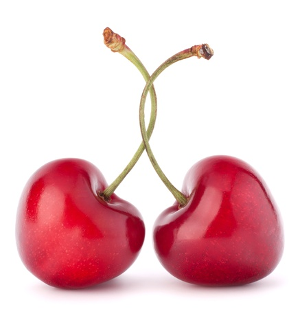 sweet love: Two heart shaped cherry berries isolated on white background cutout