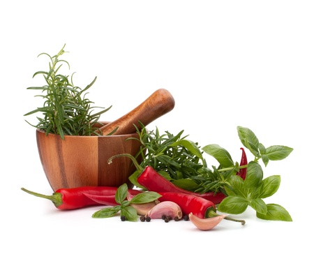 fresh flavoring herbs and spices in wooden mortar isolated on white background Stock Photo - 14617885