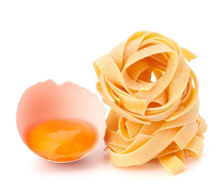 Italian egg pasta fettuccine nest isolated on white background photo