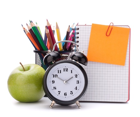 Alarm clock, blank notebook sheet and apple. Schoolchild and student studies accessories. Back to school concept. Stock Photo - 14751608