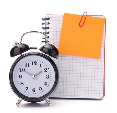 Alarm clock and  blank notebook sheet. Schoolchild and student studies accessories. Back to school concept. Stock Photo - 15184715