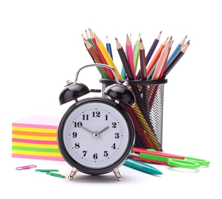 Alarm clock, notebook stack and pencils. Schoolchild and student studies accessories. Back to school concept. Stock Photo - 15184727