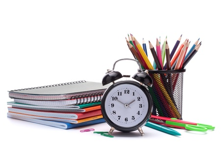 Alarm clock, notebook stack and pencils. Schoolchild and student studies accessories. Back to school concept. Stock Photo - 15184777