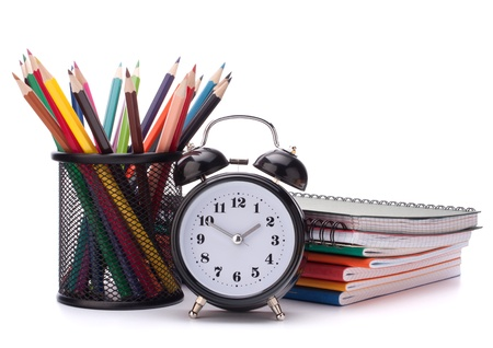 Alarm clock, notebook stack and pencils. Schoolchild and student studies accessories. Back to school concept. Stock Photo - 14907952