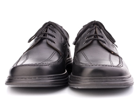 Black glossy mans shoes with shoelaces isolated on white background photo