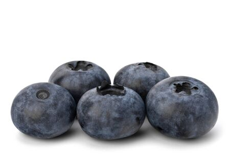 bacca: Bilberries or whortleberries cutout isolated on white background Stock Photo