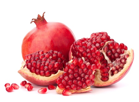 pomegranates: Ripe pomegranate fruit isolated on white background cutout