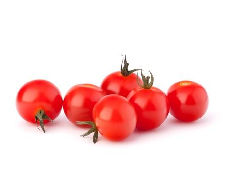 tomate cherry: Peque�o tomate cereza sobre fondo blanco de cerca