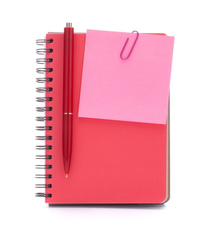 Red notebook with notice paper and pen isolated on white background cutout photo
