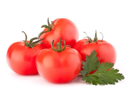 Tomato vegetables and parsley leaves still life isolated on white background cutout photo