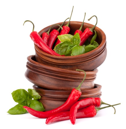 Hot red chili or chilli pepper in wooden bowls stack  isolated on white background cutout photo