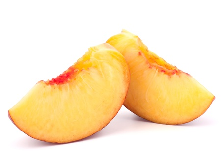 Ripe peach  fruit slice isolated on white background cutout photo
