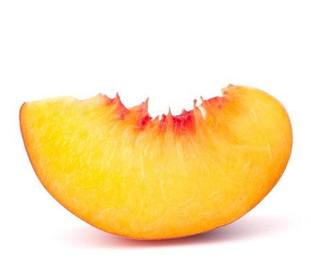 intact: Ripe peach  fruit slice isolated on white background cutout