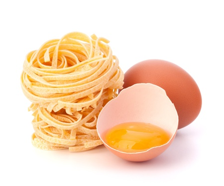 maccheroni: Italian pasta tagliatelle nest isolated on white background Stock Photo