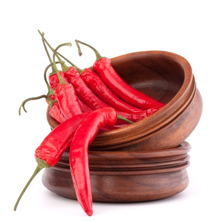 Hot red chili or chilli pepper in wooden bowls stack  isolated on white background cutout Stock Photo - 15729830