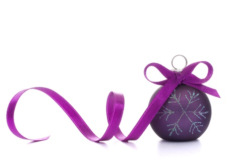 purple ribbon: Christmas ball isolated on white background cutout
