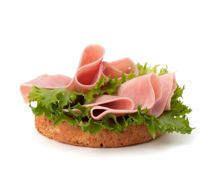 healthy sandwich with lettuce and smoked ham  isolated on white background photo