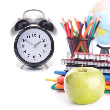 Alarm clock, notebook stack and pencils. Schoolchild and student studies accessories. Back to school concept. Stock Photo - 16195086