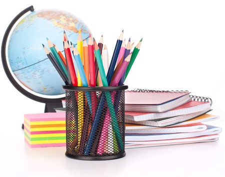 Globe, notebook stack and pencils. Schoolchild and student studies accessories. Back to school concept. Stock Photo - 16195063
