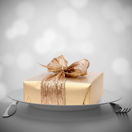 Luxurious gift on plate. Feast concept. photo