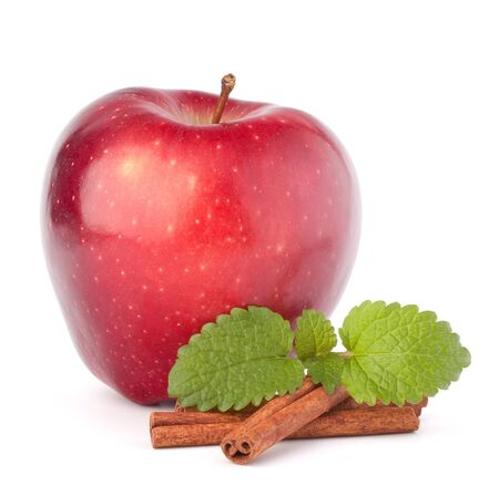 Red apple, cinnamon sticks and mint leaves still life isolated on white cutout.
