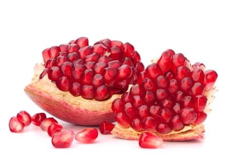 Broken pomegranate segment isolated on white background cutout photo