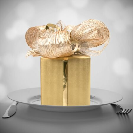 Luxurious gift on plate. Feast concept.