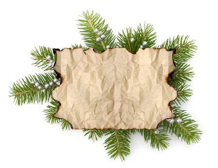 Old parchment paper with copy space on Christmas tree branch background isolated photo