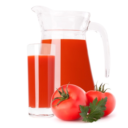 Tomato vegetable juice in glass jug isolated on white background cutout photo
