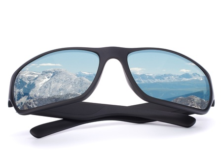 Black sunglasses with mountain reflection on isolated white background. Winter sports or vacation concept. Stock Photo - 17409762
