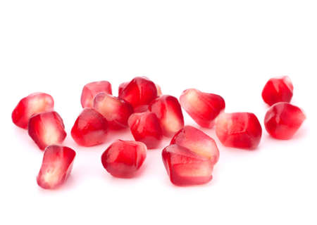 Pomegranate seed pile isolated on white background cutout photo