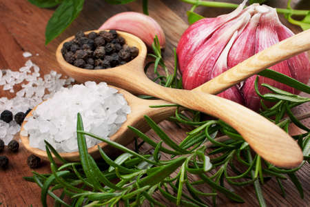 Fresh herbs and salt spoon on vintage wooden background. Shallow focus. Stock Photo - 17909713