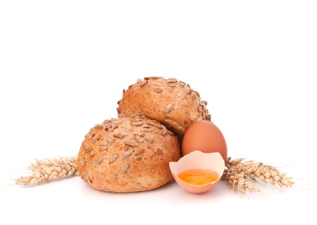 Bun with seeds and broken egg isolated on white background Stock Photo - 18072691