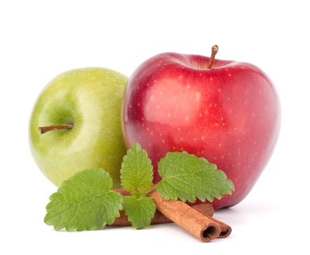 Red and green apples, cinnamon sticks and mint leaves still life isolated on white cutout photo