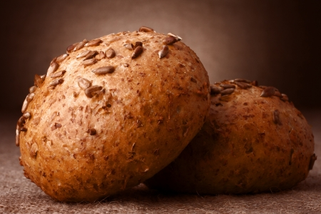 Sesame seeds buns on rustic background photo