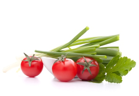 Spring onions and cherry tomato in bowl isolated on white background cutout photo